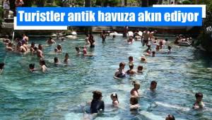 Turistler antik havuza akın ediyor