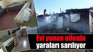 Evi yanan ailenin yaraları sarılıyor