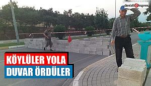 Köylüler yola duvar ördüler