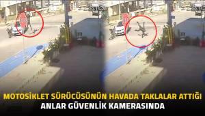 Motosiklet sürücüsünün havada taklalar attığı anlar güvenlik kamerasında