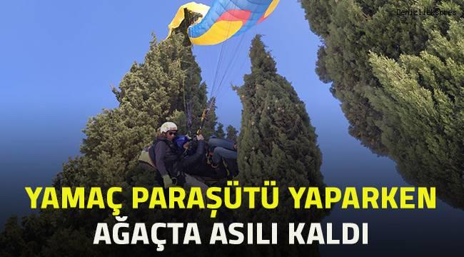 Yamaç paraşütü yaptıkları sırada ağaçta asılı kaldı