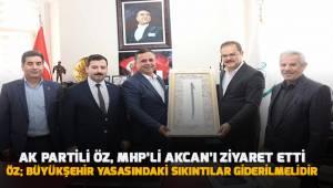 AK Partili Öz, MHP'li Akcan'ı ziyaret etti