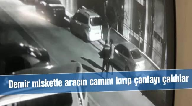Demir misketle aracın camını kırıp çantayı çaldılar